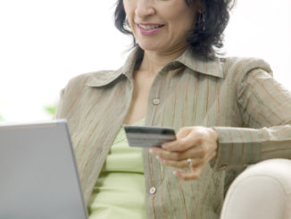 Woman Using Her Credit Card Online