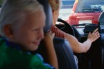 Son Sitting Behind Mother in Car